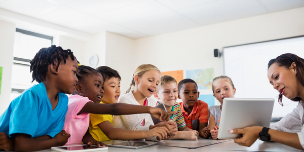 Group of Kids Studying Through Laptop.
